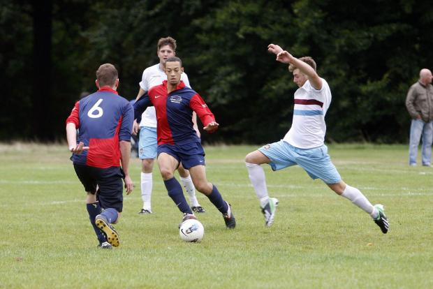 Tudor Arms (white shirts) are one of the four Watford sides through to the semi-finals of the Herts Sunday Intermediate Cup. Picture: Holly Cant