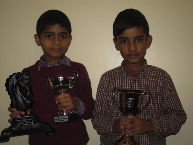 Jeff Tomy (left) and Divyesh Bansal (right) holding their trophies.