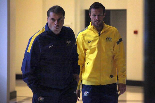 Australia manager Ange Postecoglou with his captain Lucas Neill. Picture: Action Images