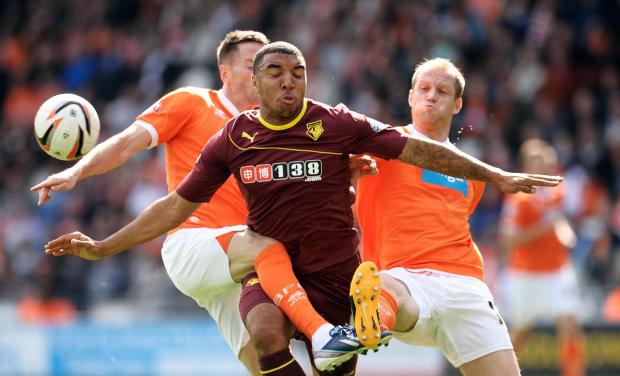 Sandwiched: Troy Deeney in action against Blackpool earlier this season. Picture: Action Images