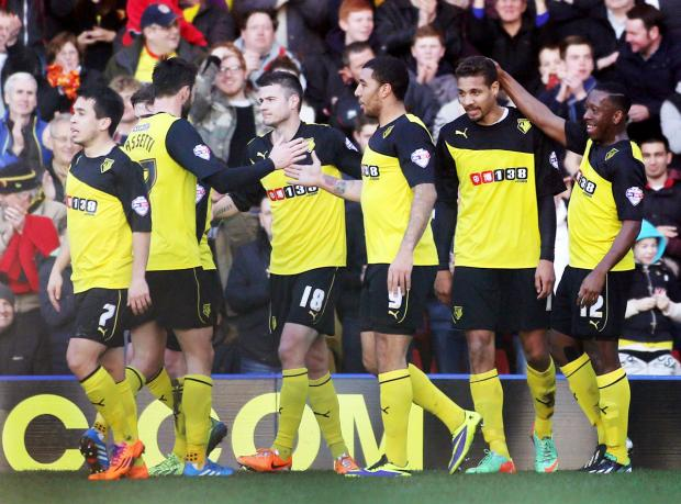 The Hornets players celebrate one of Mathias Ranegie's goals. Picture: Action Images