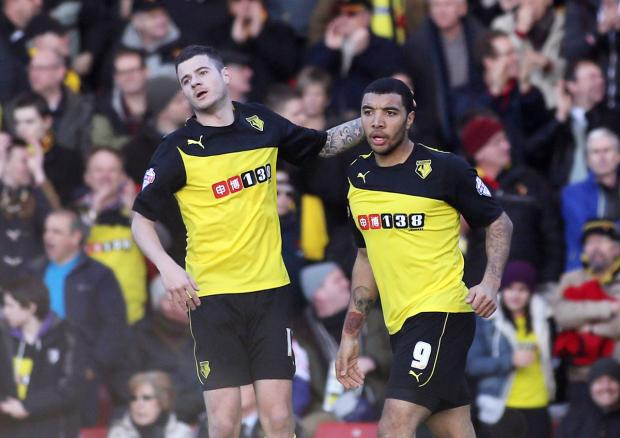 A half-century of Hornets goals: Troy Deeney celebrates with Daniel Pudil on Saturday. Picture: Action Images