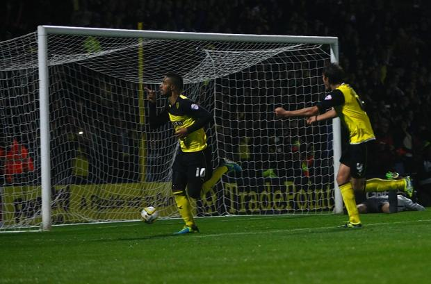 Watford Observer: Lewis McGugan celebrates his winning goal against Doncaster Rovers in the corresponding fixture in September. Picture: Holly Cant