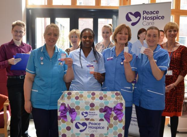 Nurses and staff pick the winners of the Peace Hospice Care winter lottery.
