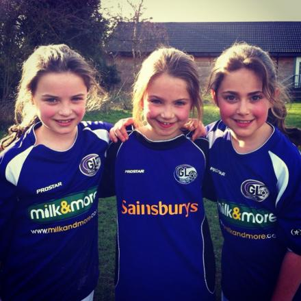 All smiles: three younger Garston Ladies players.