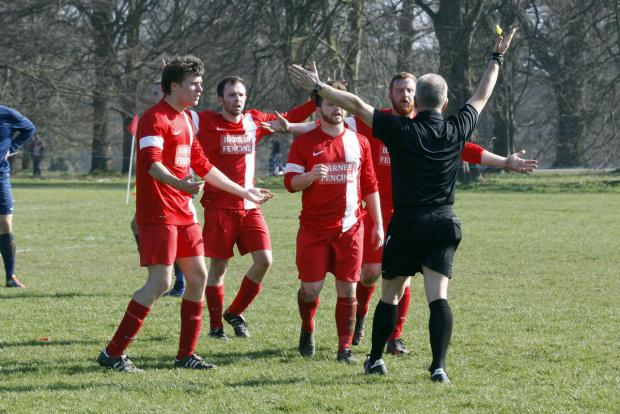 Flashpoint: the Rifle Volunteer plays protest to the referee during their semi-final victory. Picture: Holly Cant