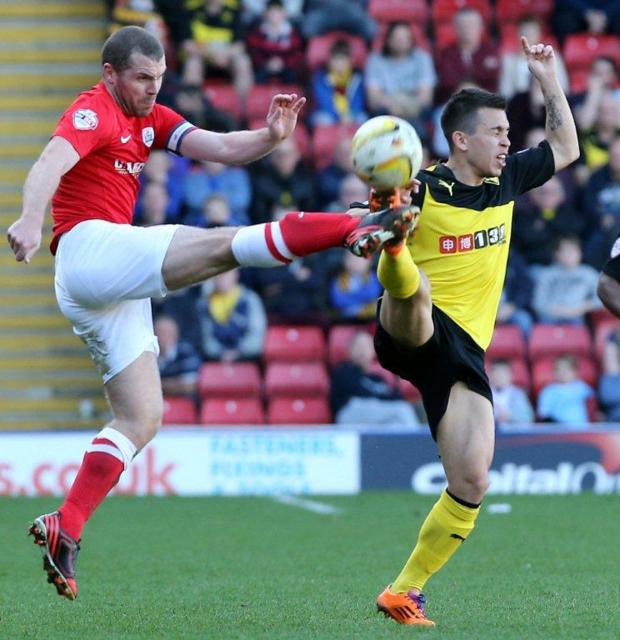 Watford Observer: Cristian Battocchio battling for the ball with Barnsley's Stephen Dawson. Picture: Dave Peters.