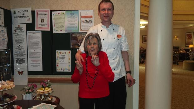 Sunrise of Chorleywood's dining room services co-ordinator Michal Rebeka with resident Olly Drum