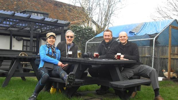 Hikers Helen Liversidge, Colin Liversidge, Nathan Richardson and Richard Hillier are picture having a well deserved pint at the Bell pub