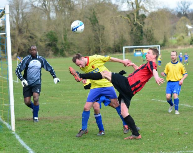 Putting a head in where it could hurt: AFC Bushey encountered few problems in their Invitation Cup clash against Sun Postal Sports, winning 7-0