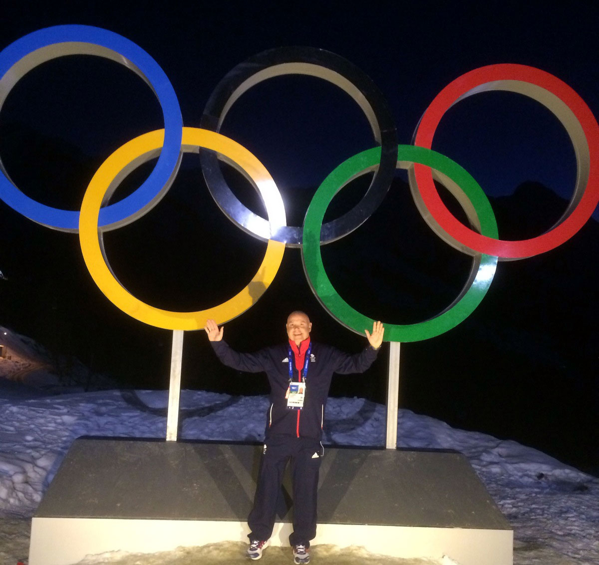 Gary Anderson and the Olympic rings in Sochi.