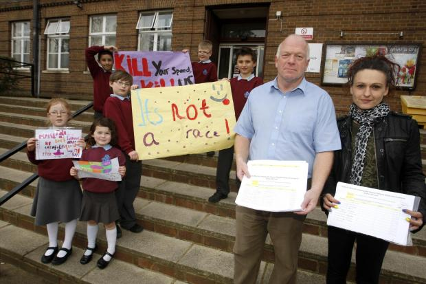 Nikki Pengelly with Stephen Giles- Medhurst on steps of Watford council with petition to improve road safety outside Parkgate Junior School