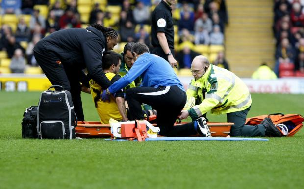 Watford Observer: Cristian Battocchio is helped onto a stretcher. Picture: Holly Cant