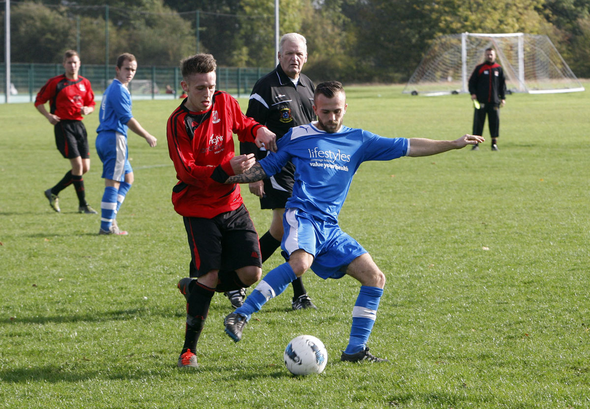 St Josephs (red shirts) could clinch the Premier Division title on Sunday. Picture: Holly Cant
