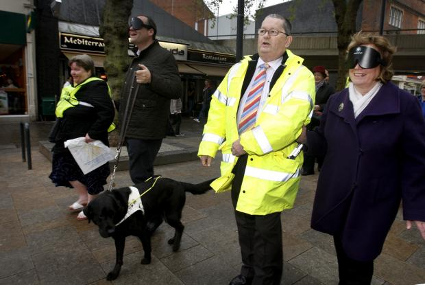 Guide dog owners blindfold Watford mayor and MP