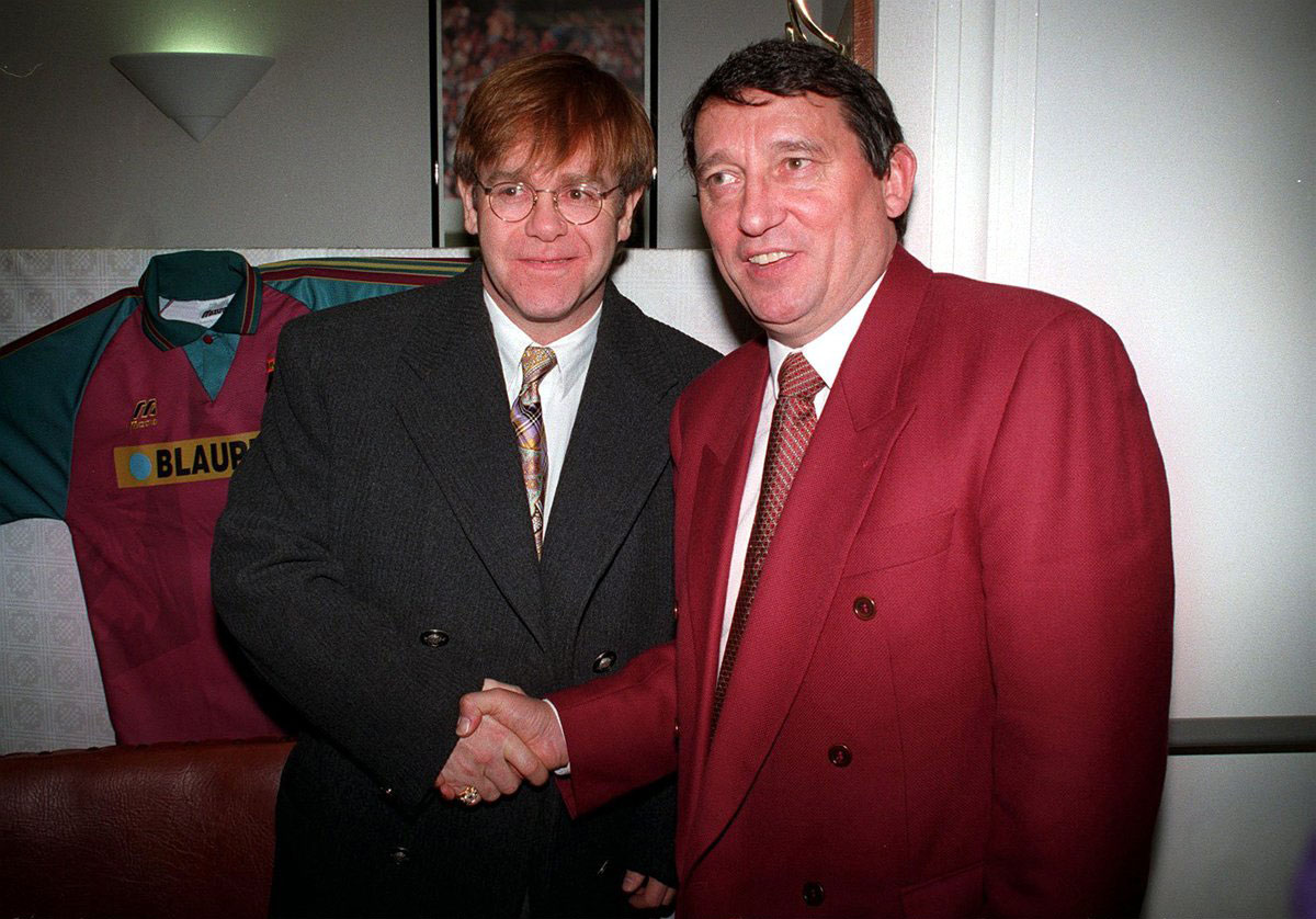 Back together again: Graham Taylor with Elton John at Vicarage Road in 1996. Picture: Action Images