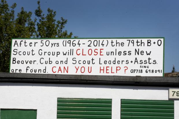 Scout group facing closure due to lack of volunteers puts up sign to attract new leaders
