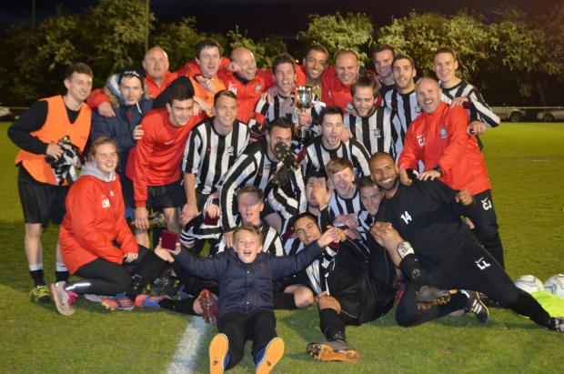 Watford Observer: Kings Langley celebrate their cup win. Picture: Chris Riddell