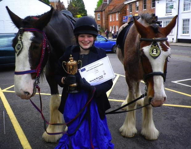 Photo by Robert Mackenzie. Pictured are Shire Horses Harvey and Joshua from Chiltern Open Air Museum with volunteer Emily Everitt