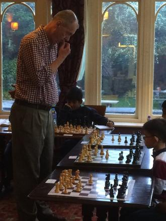 Junior chess players given a chance to face off against adult competitors