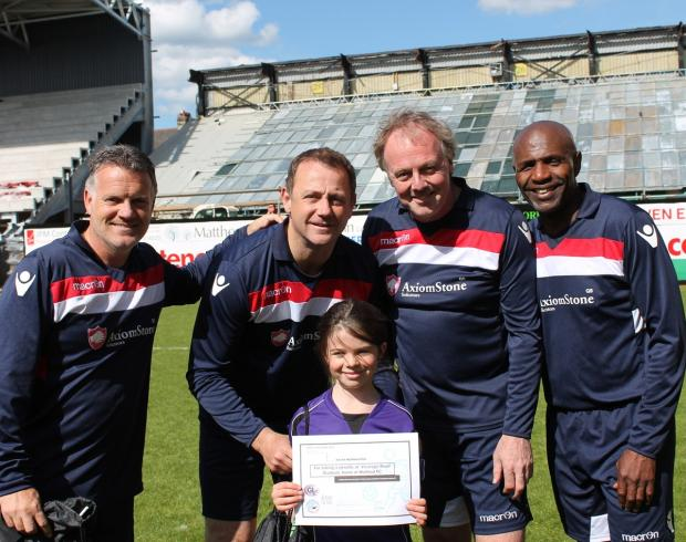 Andy Sinton, SteveSedgley,KerryDixon and Luther Blissett pictured with Garston Ladies penalty taker Keira Hemington.