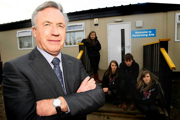 Watford Observer: Kings Langley Secondary School headteacher Gary Lewis with pupils in front of current facilities