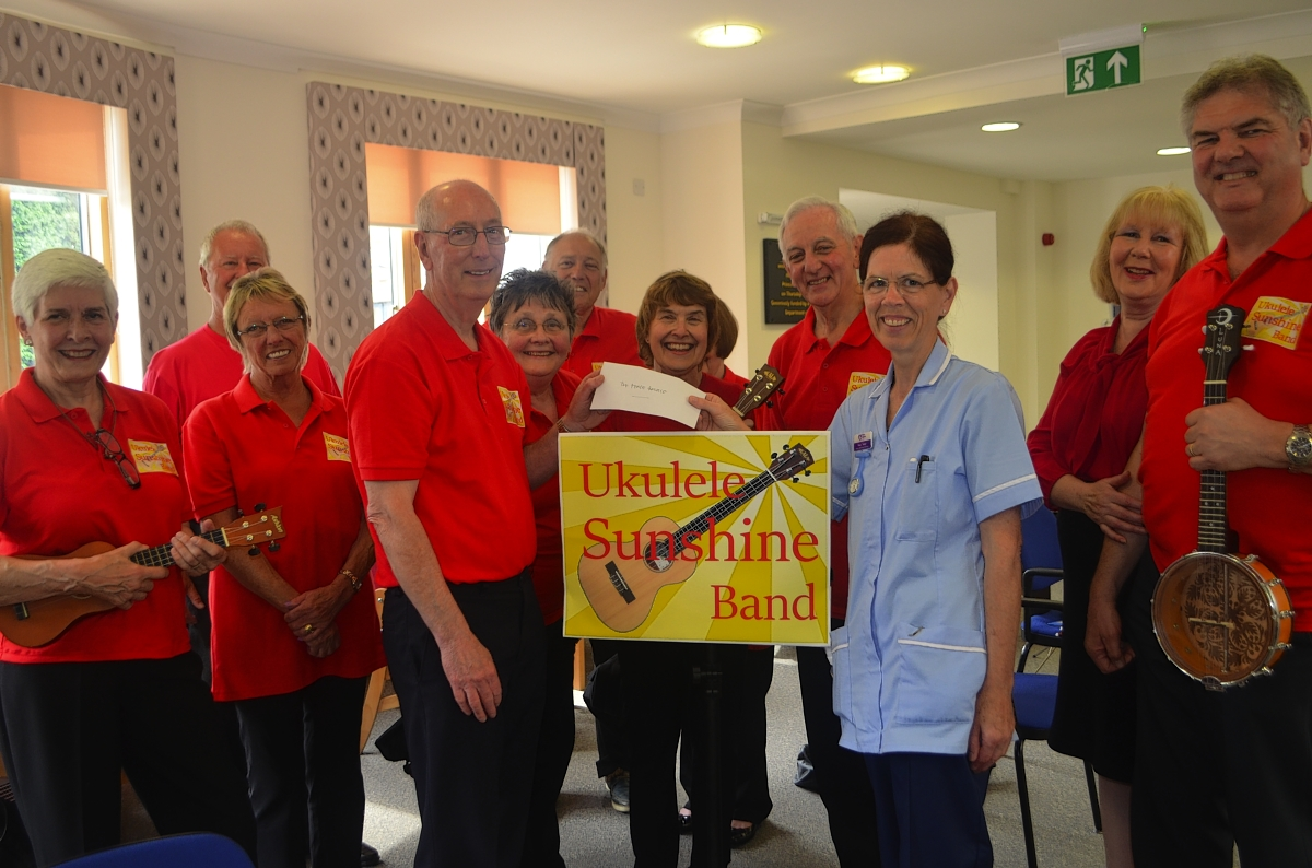 Ukulele Sunshine Band entertains staff and patients at Peace Hospice Care