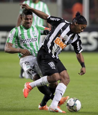 Watford target Alexander Mejia challenges Ronaldinho during last month's Copa Libertadores clash. Picture: Action Images