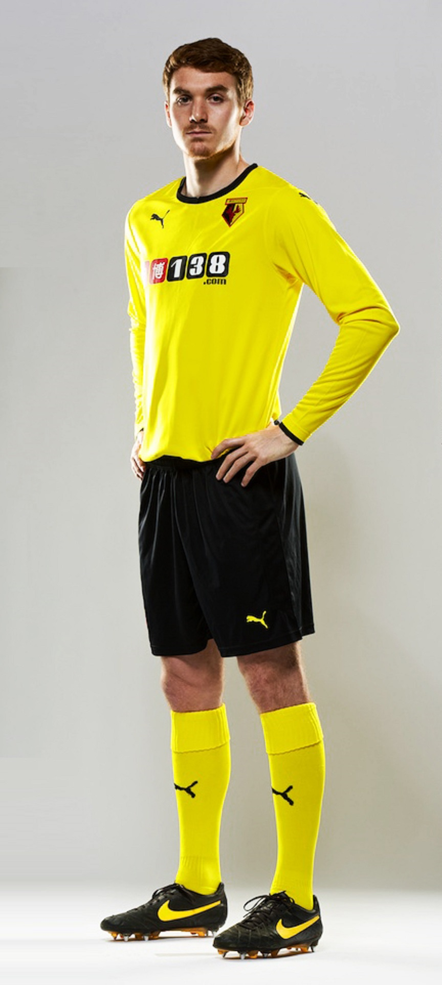 Tommie Hoban models the yellow and black combination that Watford will wear this season.