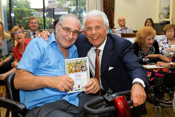 Volunteer Martyn Fairbanks (left) pictured with Jewish Care President Lord Levy