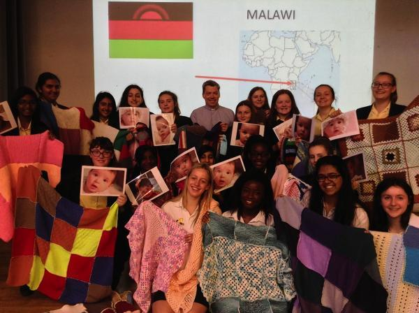 Watford schoolgirls and staff knit 60 blankets for Malawian babies