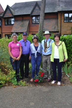Rose planting left to right: Rose gardener Ami Cowley, Norman Vincent and Diana Brown from The Friends of Bushey Rose Garden, and the Mayor and Mayoress