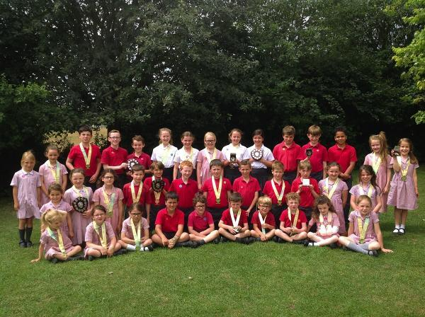 Bushey primary school pupils clean up at the races