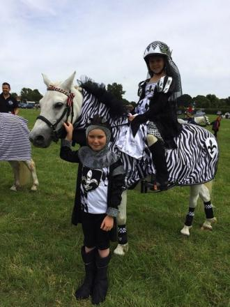 Watford schoolgirls Olivia and Maddison Wheatley scoop fancy dress award at pony show