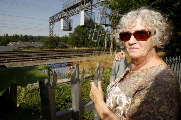 Railway gantry built behind pensioner's garden