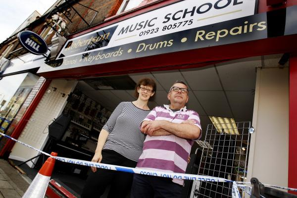 Man arrested on suspicion of drink driving after car ploughs through music shop window