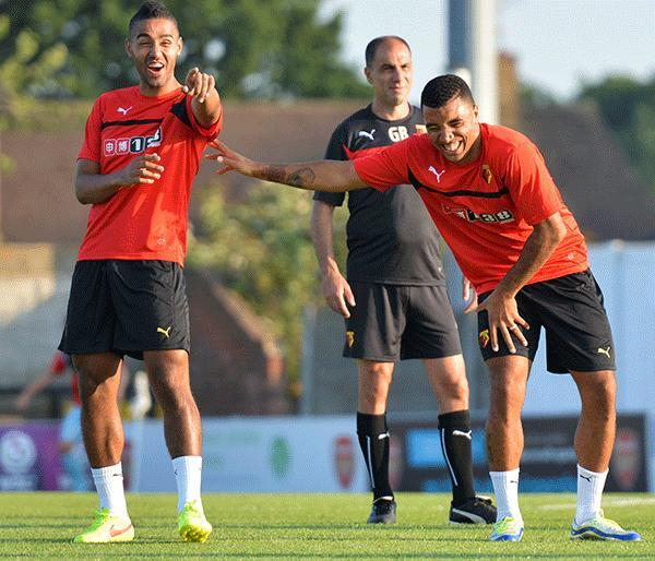 Caption this image: what has McGugan said to Deeney to make him laugh?