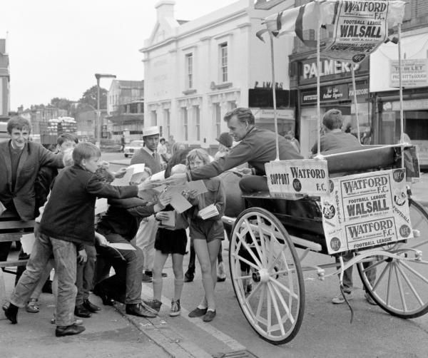 Selling Watford FC's opening game of the season yesterday was manager Ken Furphy. Using a pony and trap to get around, he distributed fixture cards in Watford's High Street precinct ... and there was no shortage of eager young clutching hands.