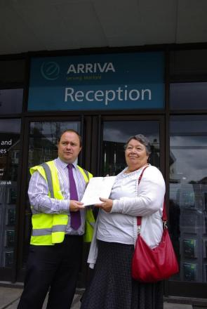 Councillor Joan King presents the petition to Steve MacDonald of Arriva Buses