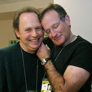 Billy Crystal, left, pictured with Robin Williams, paid tribute to the late actor at the Emmy Awards in Los Angeles (AP)