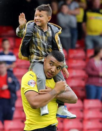 Troy Deeney and his son Myles after Saturday's victory over Leeds United. Picture: Dave Peters.