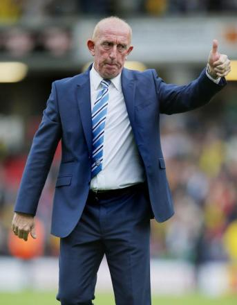 Thumbs up: Mark Lillis salutes the Huddersfield fans after the final whistle. Picture: Action Images