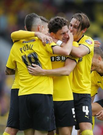 Together in celebration: Keith Andrews is congratulated after scoring his first Hornets' goal. Picture: Action Images