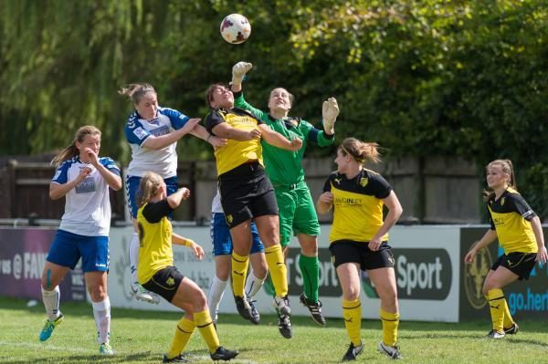 Punching under pressure: Watford keeper Lauren Davey in the thick of the action. Picture: Andrew Waller