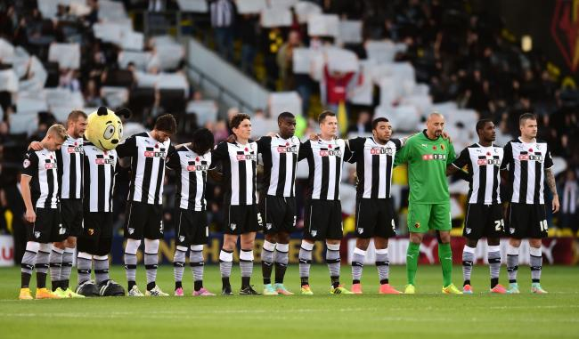 Watford's players during yesterday's minute's silence. Picture: Action Images