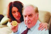 Henry Wermuth with daughter Ilana Metzger holding the medal he was awarded by the German government in 1995 for his assassination attempt on Hitler