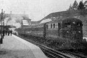 "Platform view of Croxley Green station, showing the arrival of the ""test"" train. 	[From the Watford Observer of November 11, 1925]"