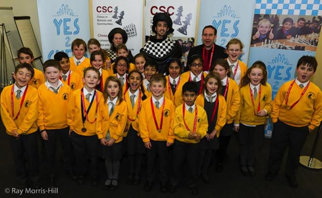 Rickmansworth school pupil checks out the competition at national chess tournament
