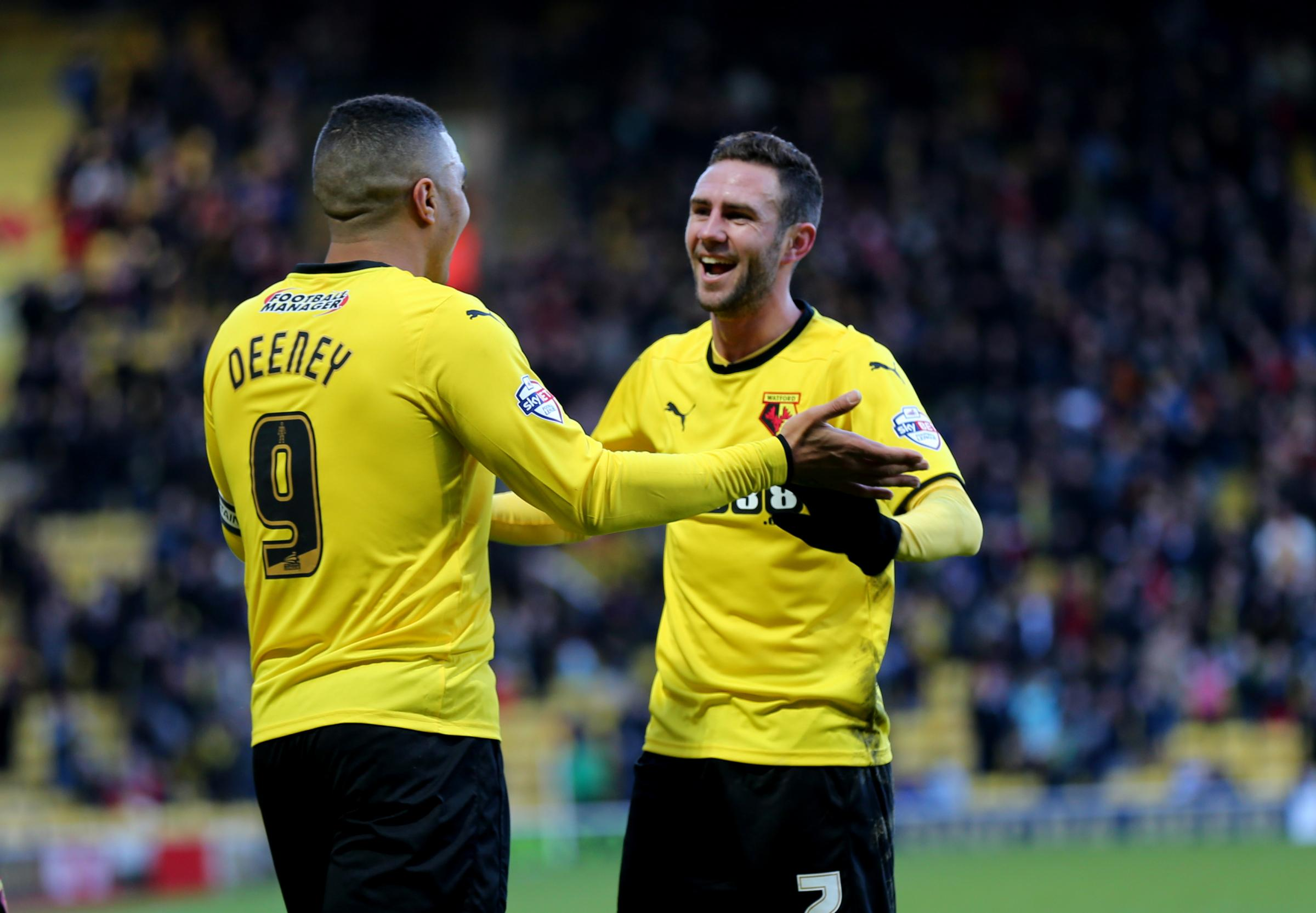 Layun (right) celebrates Troy Deeney's goal against Charlton Athletic on Saturday. Pictures: Holly Cant