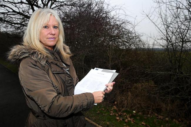 Elizabeth Tomlins with signed petition against location of phone mast
